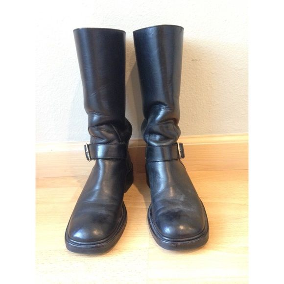 Black Leather Gucci Boots Black Leather Gucci boots with side buckle. Mid-calf height. Good Condition. No Trades Please. Gucci Shoes Combat & Moto Boots