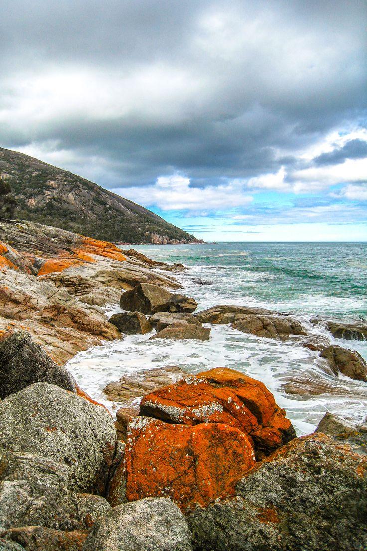 Colorful rocks at Wineglass Bay in Australia