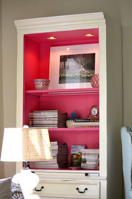paint the inside of a bookcase. this is great for adding a pop of color to a room without painting the walls. LOVE