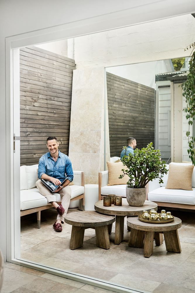 """The courtyard is now a place that Darren finds himself drawn to. """"It was a no-go zone before, but now it begs you to lie on the sofa and relax,"""" he says. Reef 3-seater sofa and Granada grey nesting tables, [Globe West](http://www.globewest.com.au/?utm_campaign=supplier/