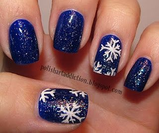 Blue glittery snowflake nail art. I plan on doing this in the winter