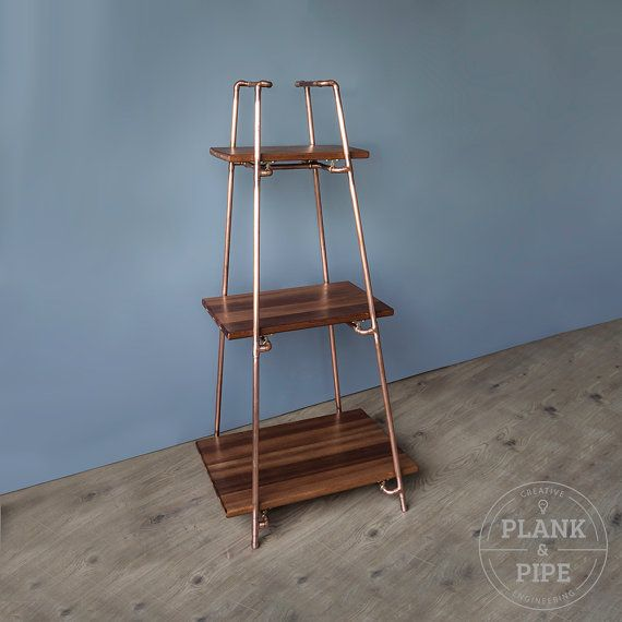 COPPER & AFRICAN SAPELE PYRAMID SHELVES: In a Natural or Polished & Lacquered finish. This handmade free-standing shelving unit is made using 15mm copper pipe and planks of African Sapele timber. Each copper joint is professionally soldered making it a strong and one solid piece. The African Sapele wood has been sealed with Oil and is Biscuit jointed, routed, sanded and then mounted on a raised floating platform using specialist brass clips. The pictures show the copper in a Polishe...