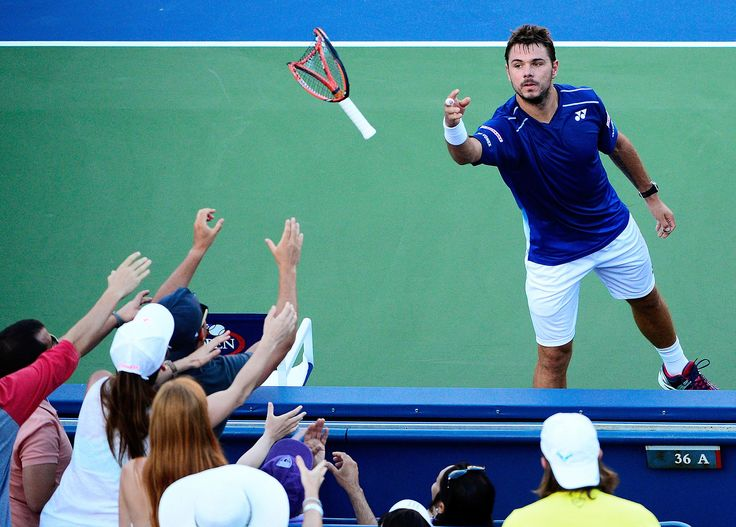 2015 US Open - Stan Wawrinka of Switzerland won against Ruben Bemelmans of Belgium in the third round; 6-3, 6-4. He throws his broken racket to fans.