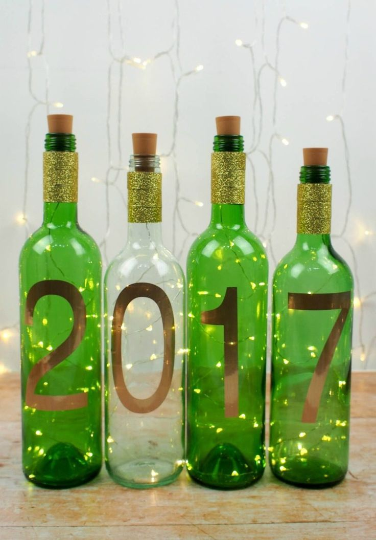 These simple DIY wine bottle light are the perfect quick New Year craft. They are a great way to recycle used wine bottles and also decorate your home.