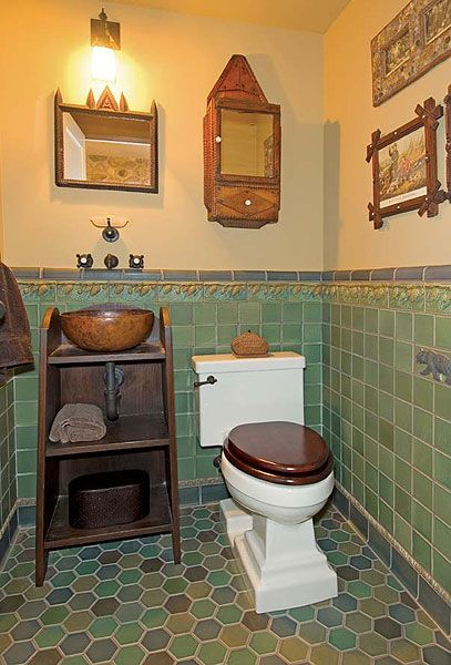 Arts and Crafts powder room.  Love the tiles on the floor!