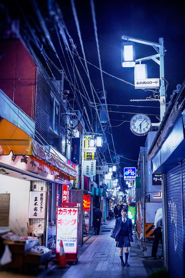 Japanese Street Fashion Trends: Narrow Tokyo Alley At Night.