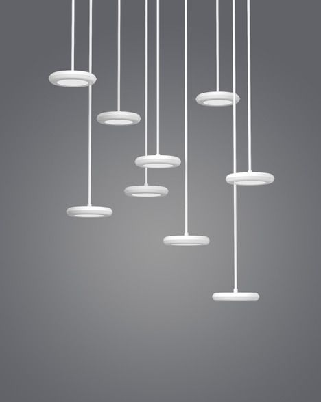 Modular suspended lighting with interchangeable glass shades, HAL Lamps by Guillaume Delvigne offer three different shapes that slip on over the lacquered metal light source.