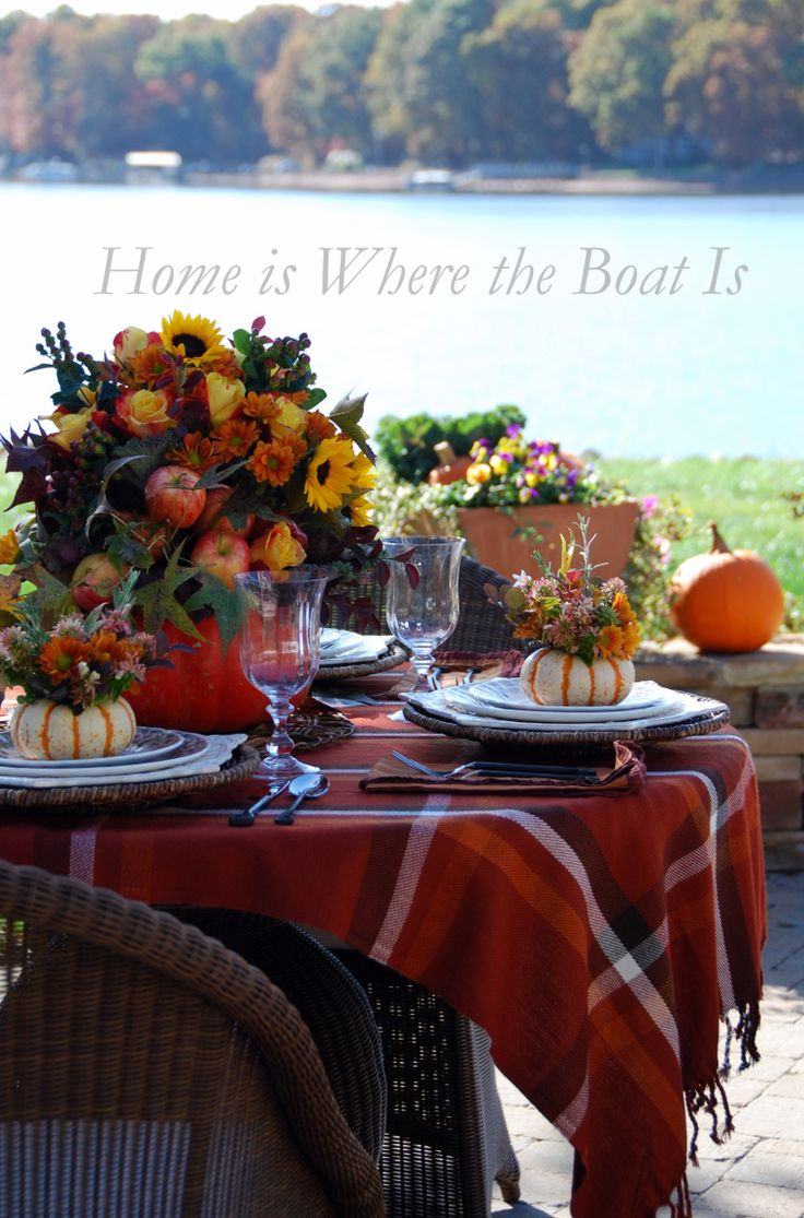 Thanksgiving lakeside with pumpkin vase centerpiece and