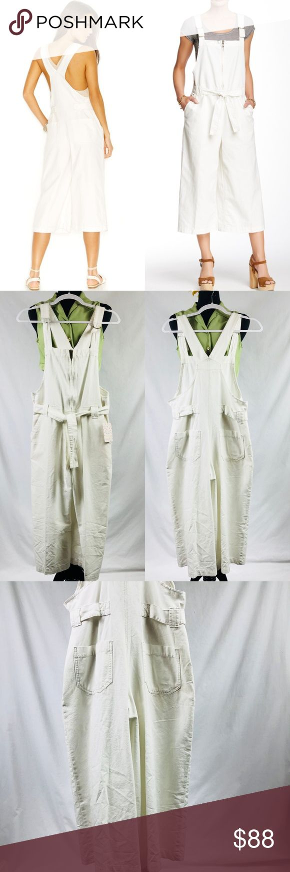 """Free People Canvas Wide Leg Overall in Ivory $148 Change up your denim game with these cute Denim Overalls. Structured cotton overall flaunts a relaxed fit, wide leg, and self-tie belt. Adjustable D-ring shoulder straps. Front zip closure. Belt loop waist attached tie detail. Slant hand pockets.Rear patch pockets.Wide straight leg. 100% cotton. Machine wash cold, tumble dry low. Imported. Approx. Measurements: Inseam: 20"""" / Overall length 45-48"""" Measurements were taken using size XS (Women's…"""