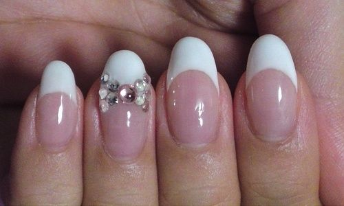 Rounded nails with french mani & bow.