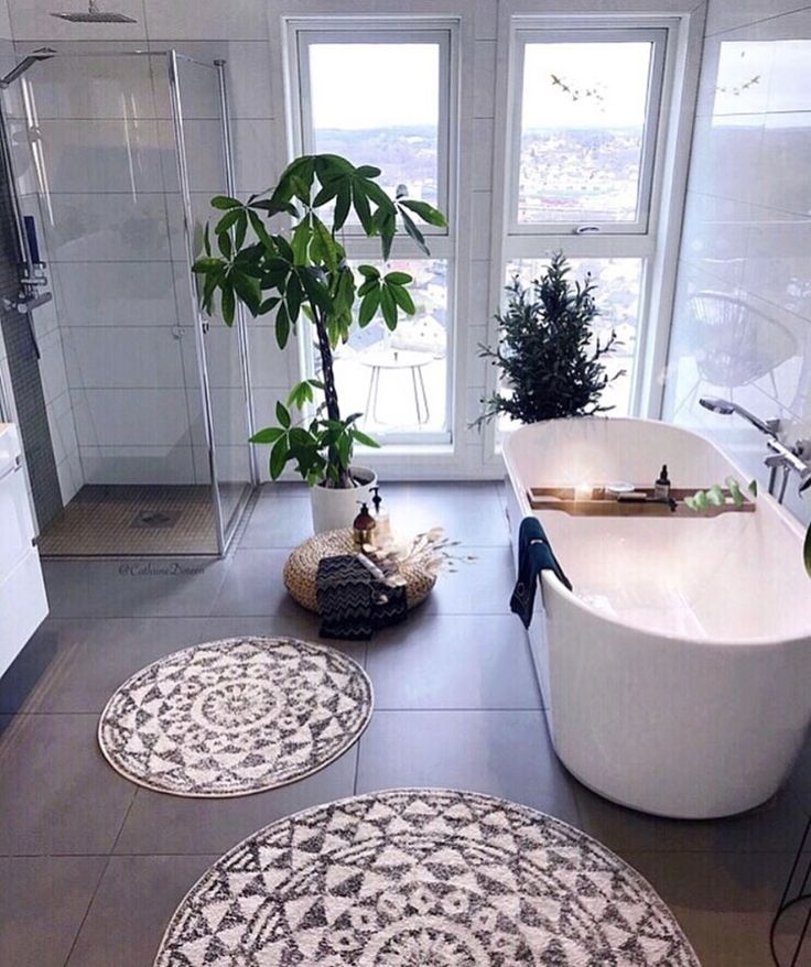 Open shower spaces, green plants, mandala rugs and…