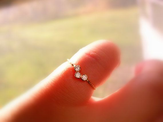 So cute & gorgeous, sparkly three stone diamond ring! Each round brilliant cut sparkly diamond set in 14k gold tube setting. Diamond is .03ct,