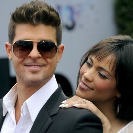 Mmmmmmm, I want to domesticate you. Robin Thicke and Paula Patton
