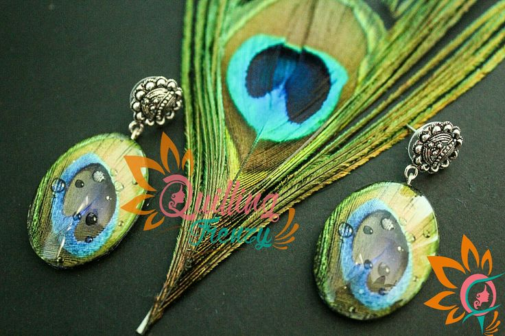 #quillingfrenzy #cabochoncraze #cabochon #earrings #peacocks #feathers #peacockfeather