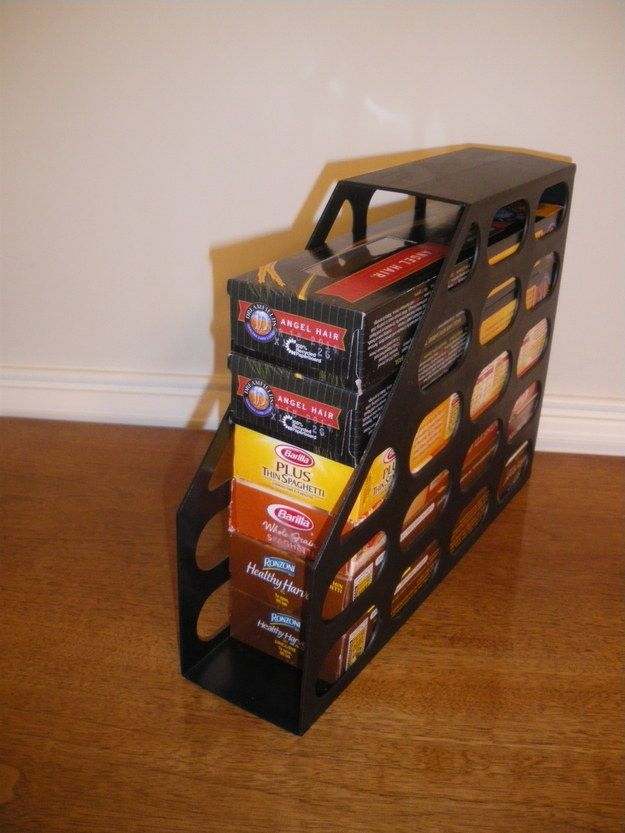 Stack spaghetti boxes in a magazine holder. | 33 Clever Ways To Organize All The Small Things