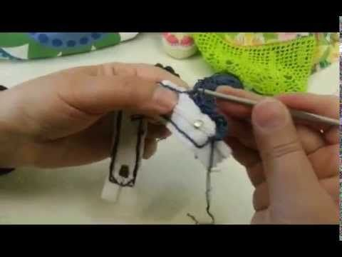 neat way to work crochet directly onto zip by sewing/tacking first - gives a neat straight edge