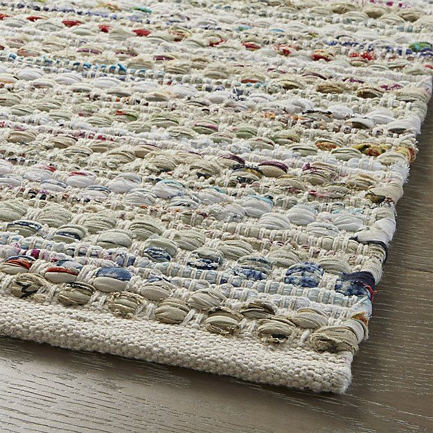 for the kitchen or entry. Shop Pinstripe Ivory Rug.  Virgin cotton and recycled fabric combine to create multicolored stripes with an emphasis on ivory.  Each Pinstripe rug is loomed with remnants of the textile and garment industries and hand woven on traditional pit looms.