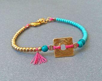 Cowrie shell bracelet Neon yellow and purple by AvitalKatzArt