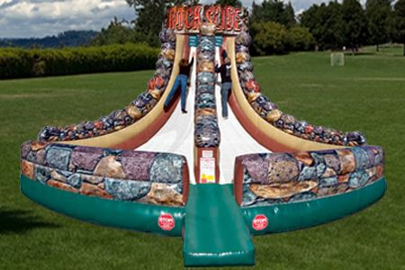 Compete on one of our newest additions – the Rock Slide!  This two person extreme challenge pushes you to your vertical limit!  Race up the slippery slope and attempt to reach the highest point before your competitor and before you slip-slide all the way to the bottom! http://texasentertainmentgroup.com/attractions/sports-inflatables/rock-slide/