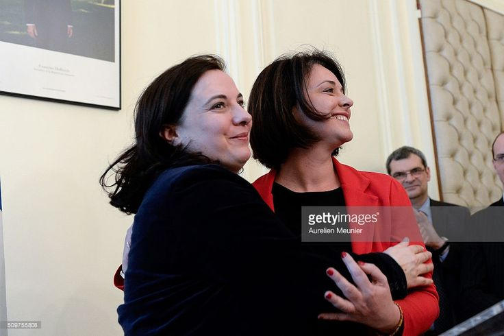 Former Minister of Housing Sylvia Pinel (R) congratulates the newly appointed French Minister of Housing, Emmanuelle Cosse (L) during the transfer of power at the Ministry of Housing on February 12, 2016 in Paris, France. Emmanuelle Cosse is part of the Green Party Europe Ecologie les Verts and she replaces former Minister of Housing Sylvia Pinel.