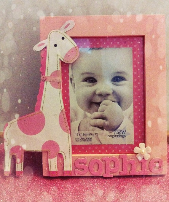 Pink giraffe photo frame.