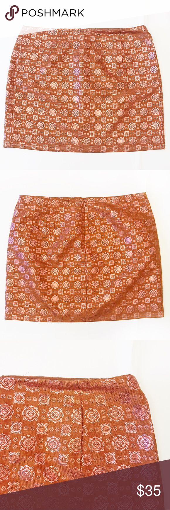 "J.CREW Brown Miniskirt w/Pink Metallic Embroidery DESCRIPTIONS: J. CREW Collection Brown Miniskirt w/ Pink Metallic Print, Size 6 - Brown miniskirt w/ Pink metallic embroidery print - FrontPin-tuck pleat detail - Back zipper with hook-and-bar closure - Lined   MEASUREMENTS (approx.):  15.5"" Length; 15.5"" Waist.   MATERIALS:  SHELL: 52% Silk; 27% Cotton; 21% Metallic  LINING: 100% Acetate  Dry clean  CONDITIONS: Great condition; Shows minimal signs of wear. J. Crew Skirts Mini"