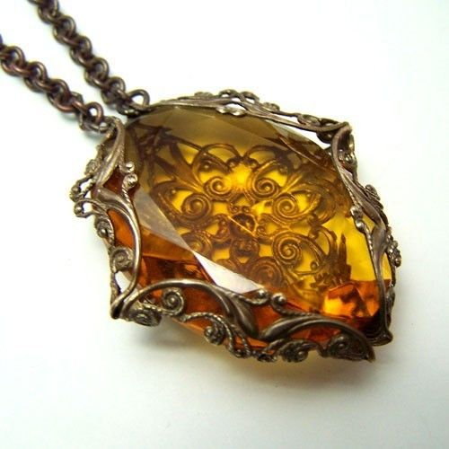 Ginormous Czech Golden Topaz Amulet. $99.01, via Etsy.