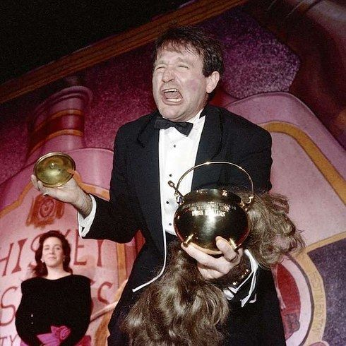 Robin Williams: A Life In Pictures - receiving Hasty Pudding Theatrical's Man of the Year award at Harvard University in 1989.