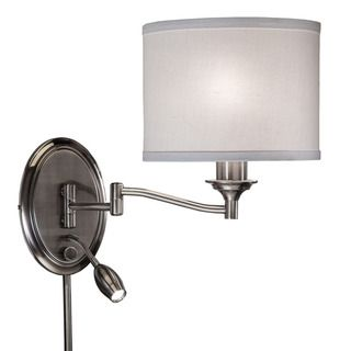 This transitional 1-light pin up plug in wall lamp features an antique pewter finish that will complement many decors throughout your home. The off white linen shade softens the light and completes th