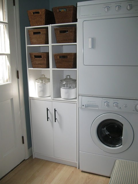 Organized laundry room shelving unit and cupboard :: baskets