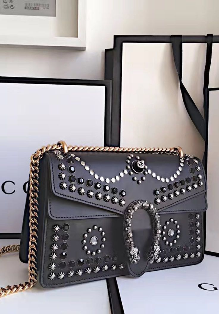 Gucci Dionysus Studded Medium Shoulder Bag is made in black leather and is enhanced by black crystal and metal studs. Find more Gucci handbags at http://www.luxtime.su/gucci-bags #ShoulderBags