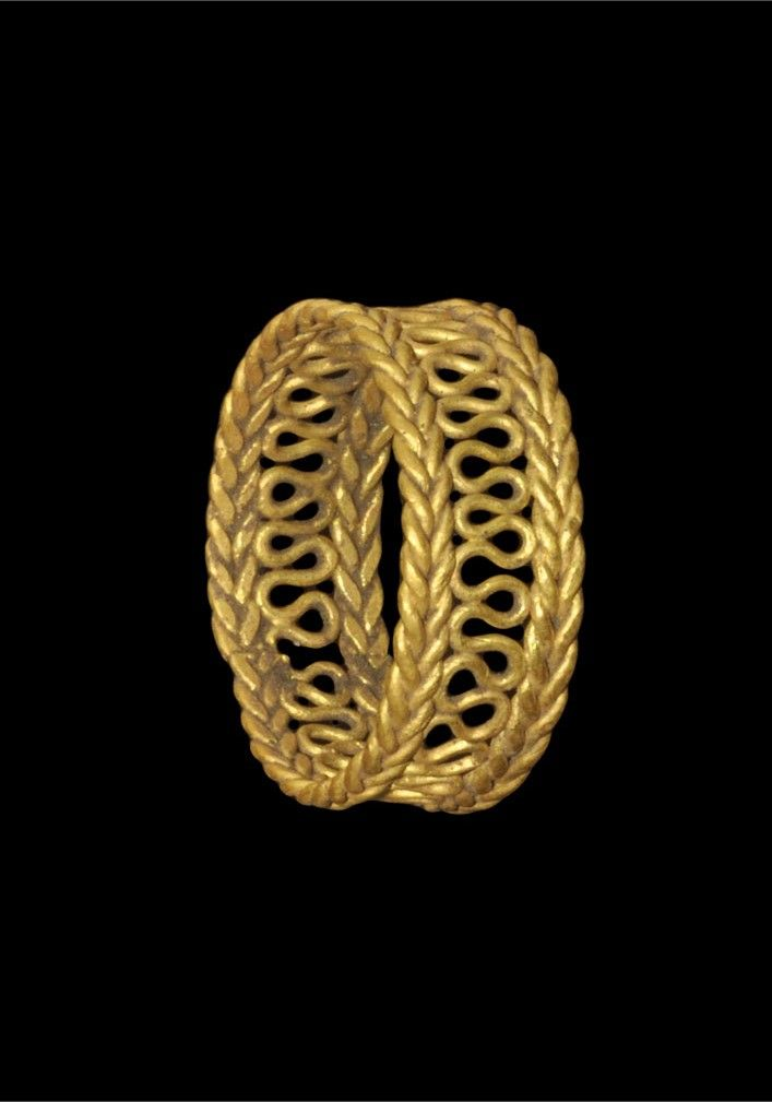 ROMAN GOLD OPENWORK RING Circa 3rd-4th century AD. A gold openwork finger ring formed with two bands of ropework filigree connected by a continuous double-looped wire. Gold