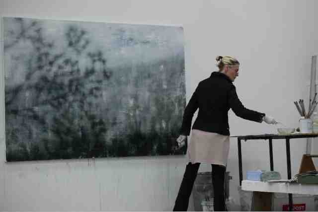 Artist Joanna Logue with one of her other-worldly works