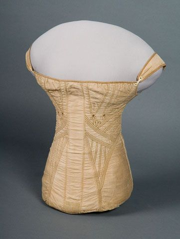 Corset: ca. 1810-1820, cotton sateen, laces up the back, upper and lower edges bound with twill tape, embroidery, no boning - a single busk in the front.