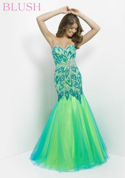 Sparkling stones and clear jewels in an abstract floral and leaf design drape down your silhouette into a two-tone dance skirt on this mermaid evening dress.
