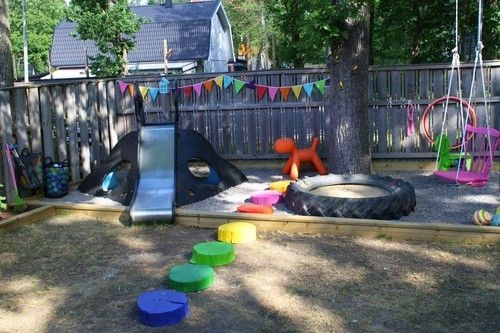 A colorful and inspired backyard playground. Looove some of these ideas. The painted wood stepping stones, the tire turned sandbox and the chair turned swing. So cute!