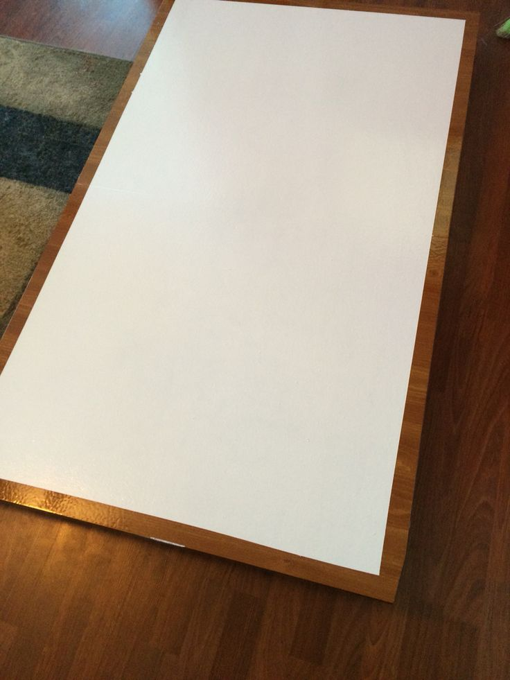 Dry erase table. Coolest study table ever. Line the table with painters tape. Then paint the table with white latex paint. We bought a white board clear cover kit from Lowes Hardware ($18). Takes a couple hours to dry but about 3 days before you can write on it.