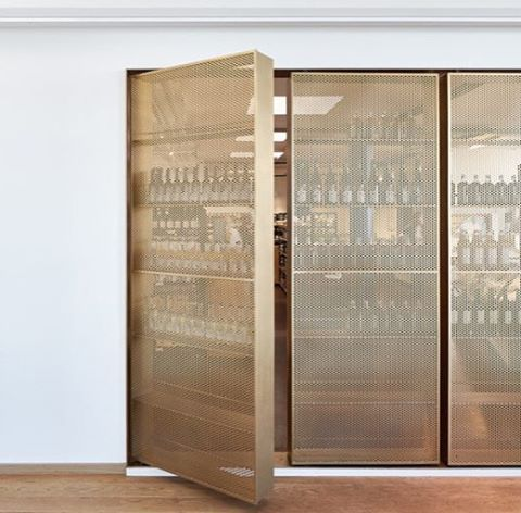 Stunning door-like beverage storage designed by Retail Architects and…