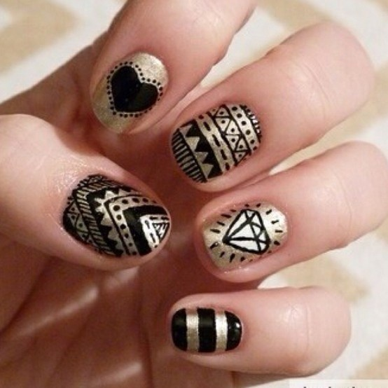 Check out these black and #gold do it yourself nail polish designs! #DIY #nails