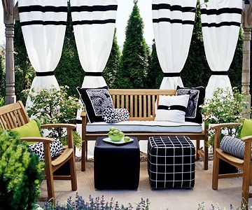 A mixture of black and white patterns add a modern feel to this secluded patio. More fabric makeovers: http://www.bhg.com/home-improvement/porch/outdoor-rooms/outdoor-fabrics-and-rooms/?socsrc=bhgpin060112#page=1Outdoor Rooms, Living Room, Black And White Curtains, Black & White Curtains, Black White, White Pattern, Outdoor Curtains, Fabrics Makeovers, Outdoor Spaces