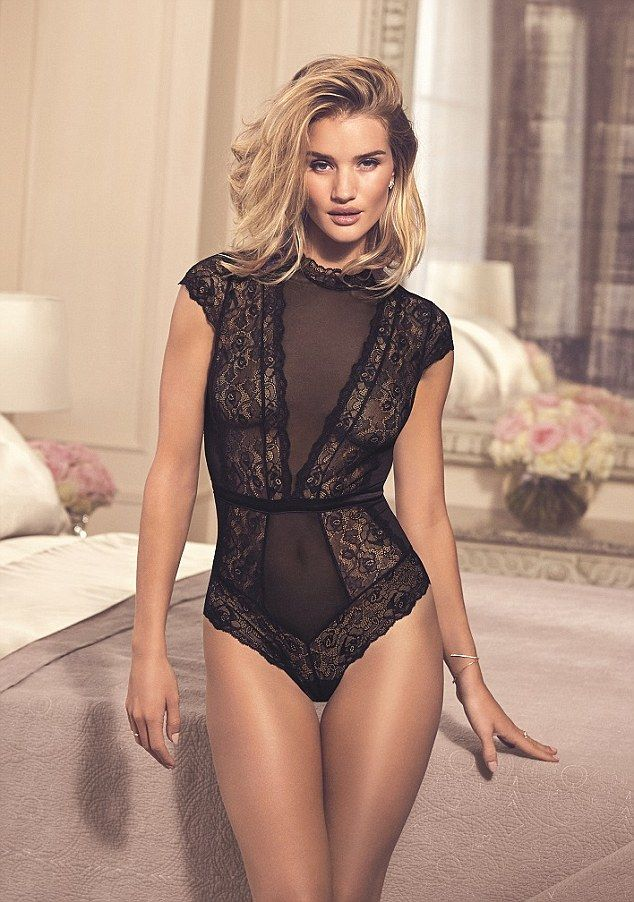 Lovely in lace:Rosie Huntington-Whiteley looked incredible as she modelled a black bodysu...