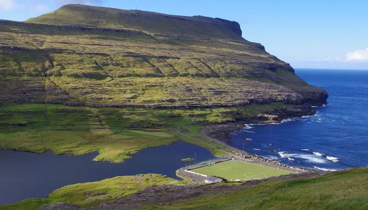 Eidi Stadium| Faroe Islands. The #Eidi #Stadium is completely surrounded by the #NorthAtlantic Ocean, providing a beautiful locale for #football in the #FaroeIslands. #EidiStadium #soccerstadiums #soccerpitch #soccer