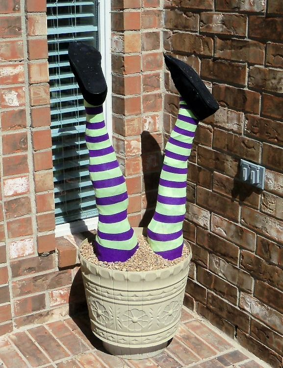 How to Make a Buried Witch Topiary. Love the simplicity; buy plastic feet/ankles; Use the pool noodle idea as legs, in addition to the stick and build from there. B.I'Me