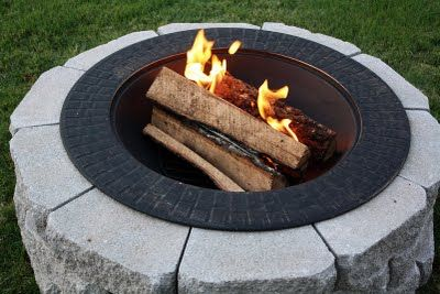 DIY firepit on a budget. Easy to assemble and take apart if needed to move or take down. Sandy W check this out...cool huh?