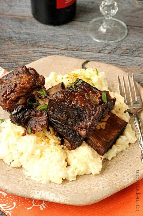 Red Wine Pomegranate Slow Cooker short Ribs with cheese grits
