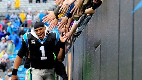 CHARLOTTE, NC - DECEMBER 22: Cam Newton #1 of the Carolina Panthers celebrates with the fans after a win against the New Orleans Saints during their game at Bank of America Stadium on December 22, 2013 in Charlotte, North Carolina. The Panthers won 17-13. (Photo by Grant Halverson/Getty Images)