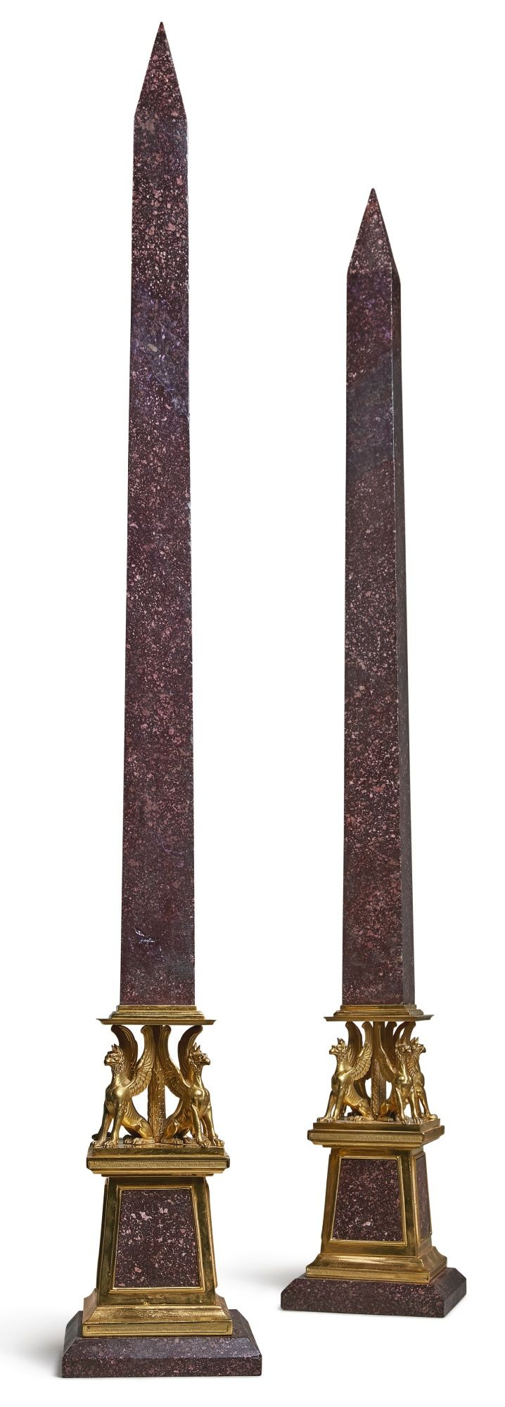 A pair of Italian Neoclassical gilt bronze and porphyry obelisks, early 19th century ||| sotheby's