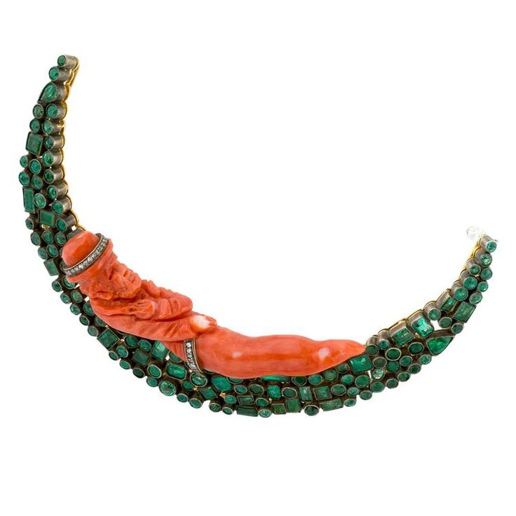 Lydia Courteille coral and emerald Moon brooch, featuring 4.85 carats of emeralds and a carved gentleman of coral. Discover the jewellery trend revival of the modern day fashion brooches: http://www.thejewelleryeditor.com/jewellery/brooches-make-fashionable-comeback/ #jewelry