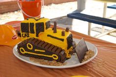 Bulldozer cake. Has a few other pictures of constructing the cake. Love the kit kat tread!