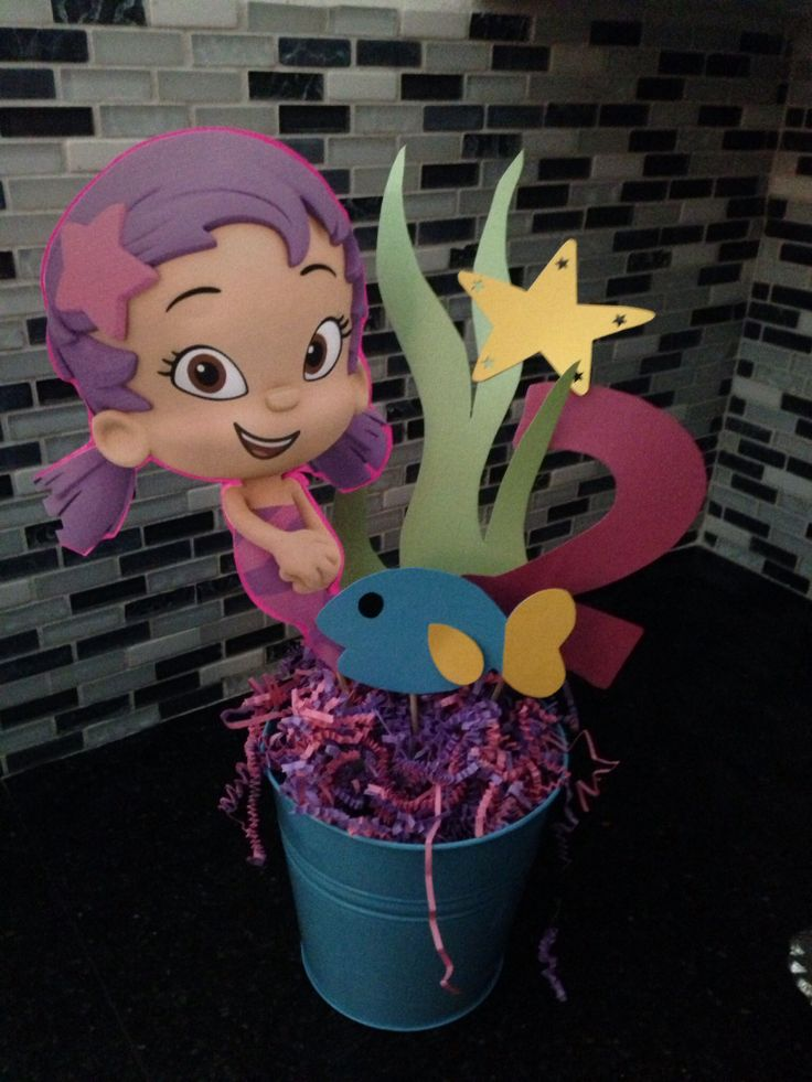 Bubble Guppies centerpiece for my daughters 2nd B-day Party. I drew seaweed, the number 2 and a fish on card stock and cut them out glued a bamboo stick on the back